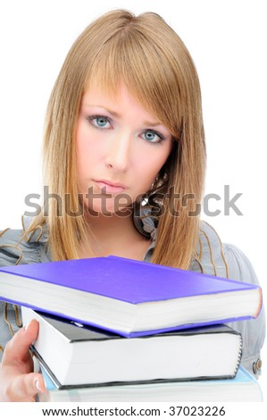 Unhappy student with a big pile of textbooks, isolated on white - stock photo