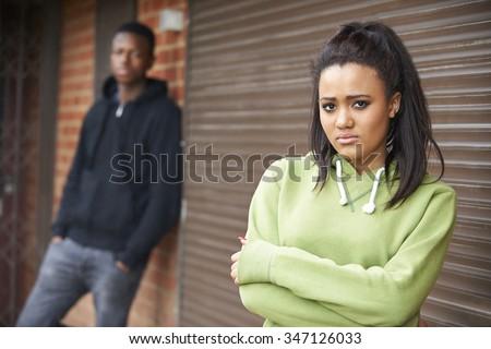 Unhappy Teenage Couple In Urban Setting - stock photo