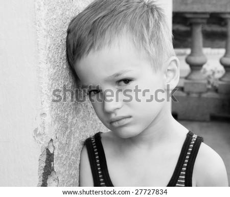 Unhappy young boy stock photo