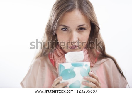 Unhappy young woman with the flu - stock photo