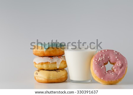 unhealthy breakfast concept. Donuts with sweets and milk - stock photo