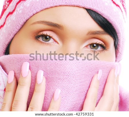 Unhealthy view of young woman having a cold. Cover by scarf - stock photo