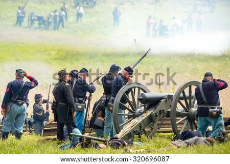 Unidentifiable union soldiers fight during the reenactment of the Civil War Battle of Gettysburg. - stock photo