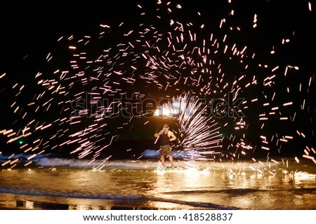 unidentified Firestarter performing amazing fire show at Koh Samed Samet island Thailand - stock photo