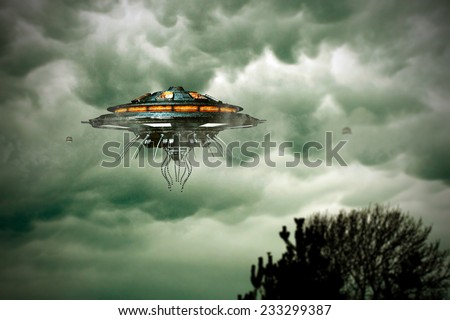 unidentified flying object flying over a tree - stock photo