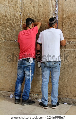 Unidentified Jewish worshipers  pray at the Wailing Wall an important jewish religious site   in Jerusalem, Israel. - stock photo