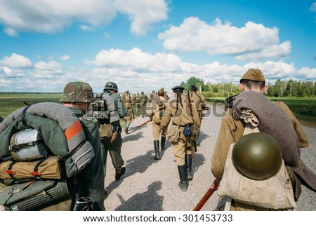 Unidentified re-enactors dressed as German and Soviet Russian soldiers 