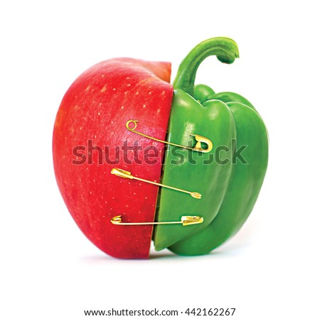 Unified of apple and pepper concept on white background - stock photo