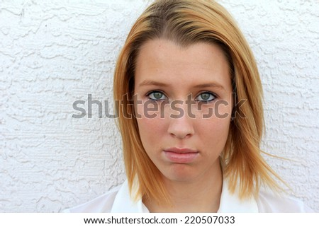 Unimpressed Teenager Upset and Bored Blonde Woman Teen College Student - stock photo