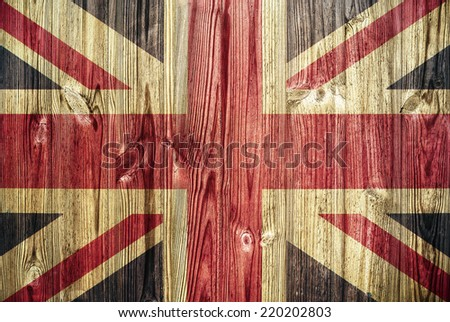 Union Jack flag on wooden background  - stock photo