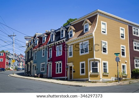 Unique architecture in the colorful houses on the steep streets of St. John's, Newfoundland. - stock photo