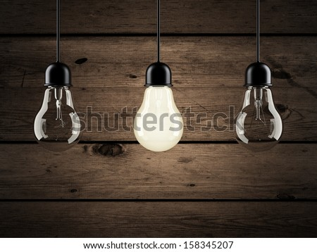 unique bulb on wooden background - stock photo