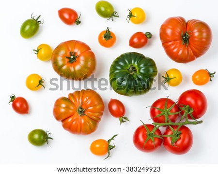 unique colorful ripe tomatoes on white background. - stock photo