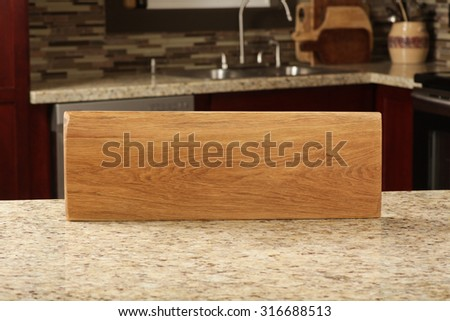 Unique cutting board on display in a modern kitchen - stock photo