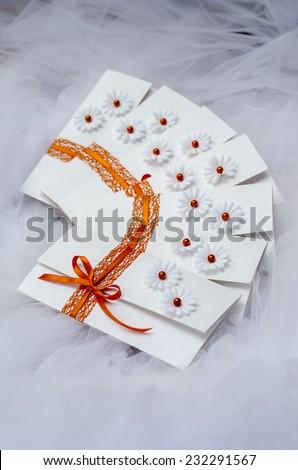 Unique handmade wedding invitations on tulle fabric. - stock photo