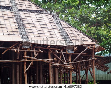 unique hard to built roof design construction of a cottage with sloped flat slap casting steel reinforced concrete under construction showing working skill and technique of the craft mans labors - stock photo