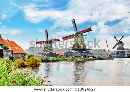 Unique old, authentic, real working windmills in the suburbs of Amsterdam, the Netherlands. - stock photo