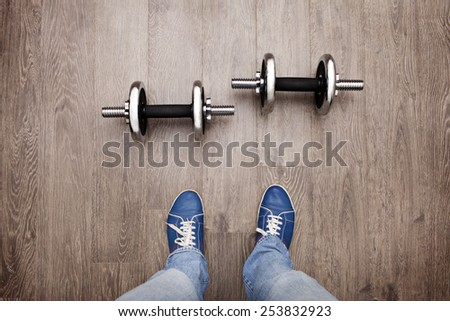 unique perspective: a look at the dumbbell like own eyes - stock photo