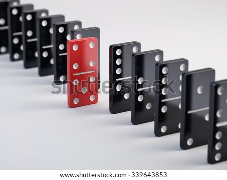 Unique red domino tile and black dominoes - stock photo
