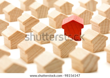 Unique wooden house in group look at you, standing out from the crowd, isolated on white background - stock photo