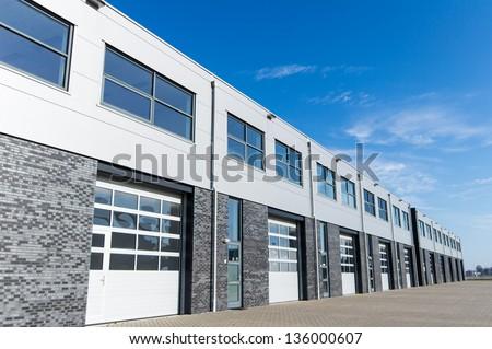 unit storage warehouse facility and blue sky - stock photo