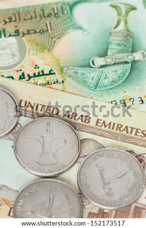 United Arab Emirates banknote and coins close-up - stock photo