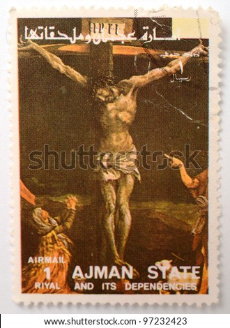 UNITED ARAB EMIRATES - CIRCA 1980: a stamp printed in the UAE shows image of Jesus on the Cross, circa 1980 - stock photo