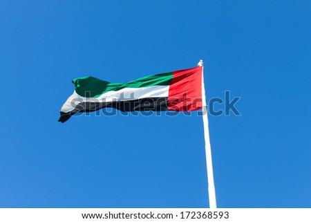 United Arab Emirates flag waving on the wind  - stock photo