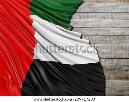 United Arab Emirates folded Flag with horizontal wood - stock photo