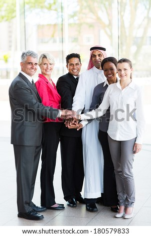 united business people putting their hands together - stock photo