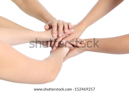 United hands of three women isolated on a white background                - stock photo