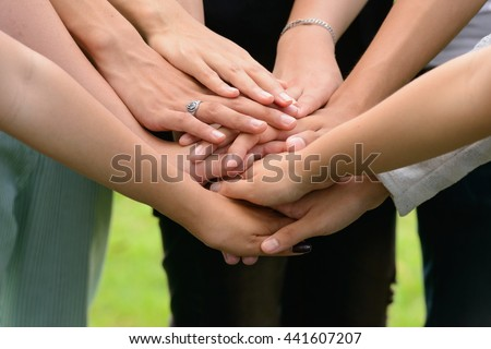 United hands outdoors - stock photo
