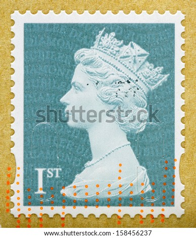 UNITED KINGDOM 2012: A used First Class postage stamp on brown envelope printed in Britain showing Portrait of Queen Elizabeth 2nd, circa 2012 - stock photo