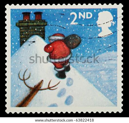 UNITED KINGDOM - CIRCA 2004: A British Used Christmas Postage Stamp showing Santa Claus, circa 2004 - stock photo