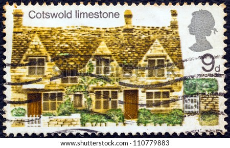 "UNITED KINGDOM - CIRCA 1970: A postage stamp printed in United Kingdom from the ""British Rural Architecture"" issue shows Cotswold limestone, circa 1970. - stock photo"