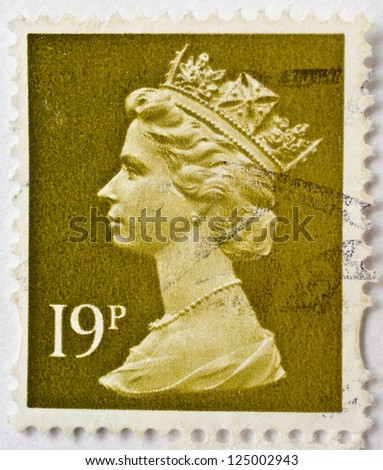 UNITED KINGDOM - CIRCA 2000: a stamp from the UK shows image of Queen Elizabeth II and value 19p, circa 2000 - stock photo