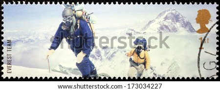 UNITED KINGDOM - CIRCA 2003: a stamp printed by UNITED KINGDOM shows Mont Everest first successful ascent by Edmund Hillary and Tenzing Norgay (1953), circa 2003. - stock photo