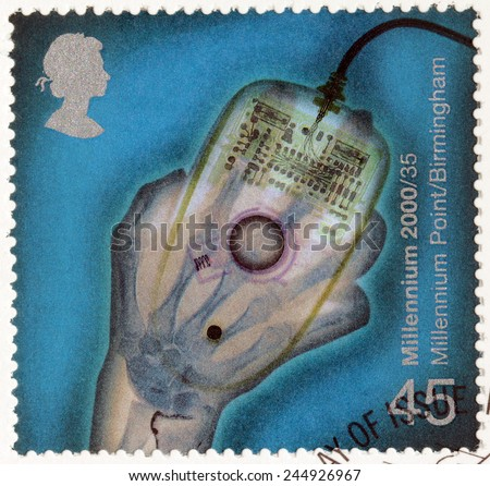 UNITED KINGDOM - CIRCA 2000: A stamp printed by UNITED KINGDOM shows X-ray of Hand holding Computer Mouse (Millennium Point), circa 2000 - stock photo