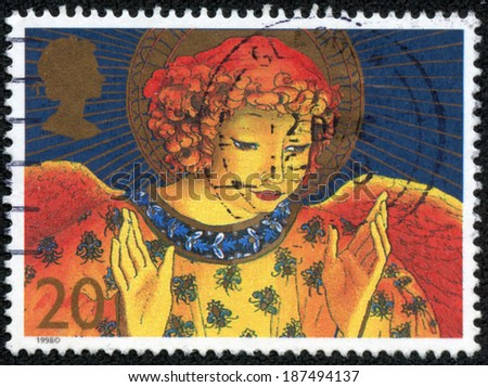 UNITED KINGDOM - CIRCA 1998: A stamp printed in Great Britain shows image of an angel, nativity, circa 1998 - stock photo