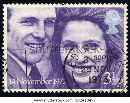 UNITED KINGDOM - CIRCA 1973: A stamp printed in the United Kingdom celebrating Royal Wedding Stamps shows Princess Anne and Captain Mark Philips, circa 1973. - stock photo