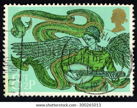 UNITED KINGDOM - CIRCA 1975: A stamp printed in the United Kingdom shows Angel with Mandolin, circa 1975 - stock photo