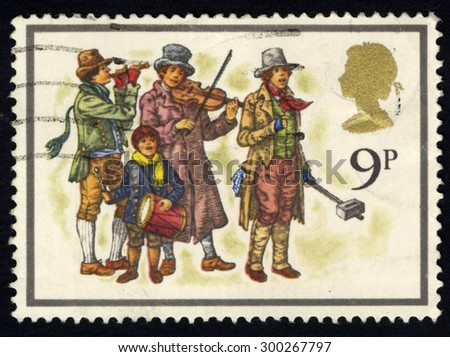 UNITED KINGDOM - CIRCA 1977: A stamp printed in the United Kingdom shows musicians, devoted Christmas circa 1977 - stock photo