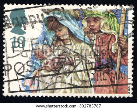 UNITED KINGDOM - CIRCA 1994: A stamp printed in the United Kingdom shows showing Nativity Scene, circa 1994 - stock photo