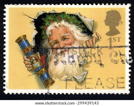 UNITED KINGDOM - CIRCA 1997: A stamp printed in the United Kingdom shows The Father Christmas with Traditional Cracker, circa 1997.  - stock photo