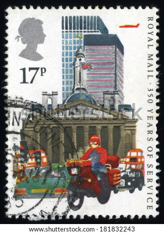 UNITED KINGDOM - CIRCA 1983: A stamp printed in United Kingdom Show the Royal Mail 350 Years of Service with Datapost Motorcyclist and City of London, circa 1983. - stock photo