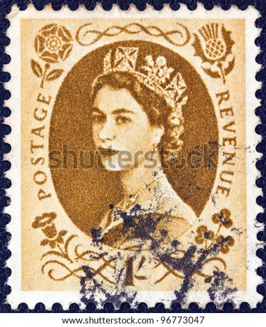 UNITED KINGDOM - CIRCA 1952: A stamp printed in United Kingdom shows a portrait of Queen Elizabeth II, circa 1952. - stock photo