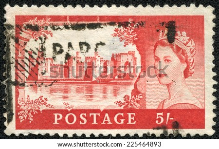 "UNITED KINGDOM - CIRCA 1955: A stamp printed in United Kingdom shows Caernarfon Castle and queen Elizabeth II, from the ""Castles"" series , circa 1955 - stock photo"