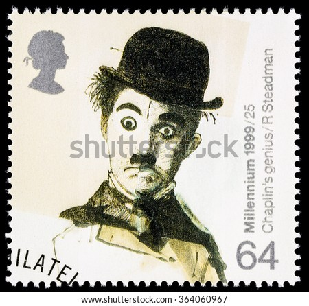 UNITED KINGDOM - CIRCA 1999: A used postage stamp printed in Britain celebrating Entertainers showing the Famous Film Star Charlie Chaplin - stock photo