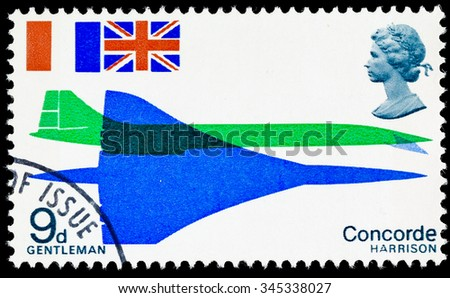 UNITED KINGDOM - CIRCA 1969: A used postage stamp printed in Britain celebrating the First Flight of Concorde - stock photo