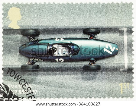 UNITED KINGDOM - CIRCA 2007: A used postage stamp printed in Britain celebrating the 50th Anniversary of the British Grand Prix showing Granham Hill in a 1962 BRM P57 - stock photo